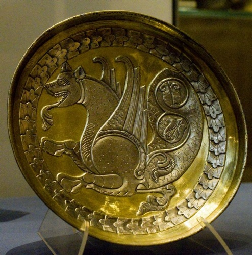 Gilded silver plate with a senmurw